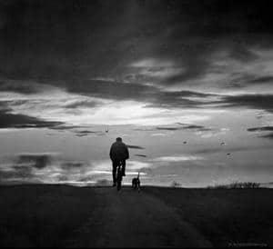 Cyclist with Dog